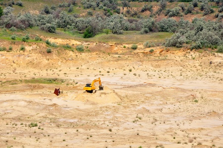 sand pit: Excavator in the sand pit, top view