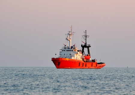 Orange rescue fire tow in the sea on sunset Stock Photo - 17433374