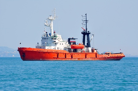 Orange rescue fire tow in the sea on anchor parking Stock Photo - 17434653