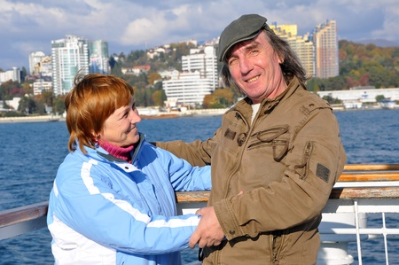 Portrait of a happy senior couple enjoying a cruise vacation photo