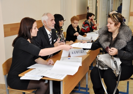 election commission: SOCHI, RUSSIA - DECEMBER 4  Voting in elections to the State Duma of the Russian Federation on December 4, 2011 in Sochi, Russia  The voter receives a ballot