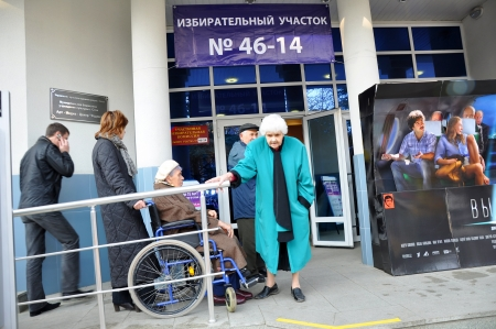 polling station: SOCHI, RUSSIA - DECEMBER 4  Voting in elections to the State Duma of the Russian Federation on December 4, 2011 in Sochi, Russia  Wheelchair at the entrance to the polling station