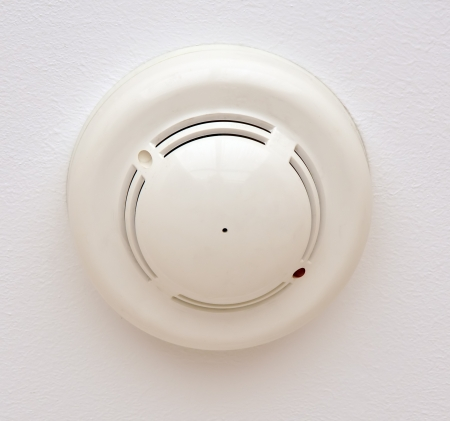 Smoke and fire detector, part of fire alarm system Stock Photo
