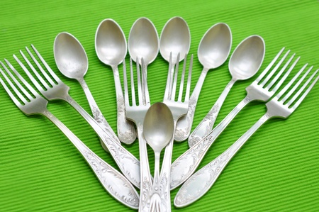 Silver spoons and forks Stock Photo