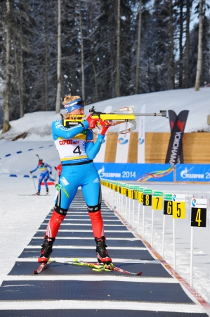 purposefulness: SOCHI, RUSSIA - FEBRUARY 10  Cup of Russia on biathlon in Sochi on February 10, 2012  The combined ski-biathlon complex  Laura  for theGames 2014  Irina Ivanova on a firing line
