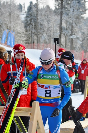 purposefulness: SOCHI, RUSSIA - FEBRUARY 10  Cup of Russia on biathlon in Sochi on February 10, 2012  The combined ski-biathlon complex  Laura  for the Games 2014  Galina Nechkasova after finish in a rest zone
