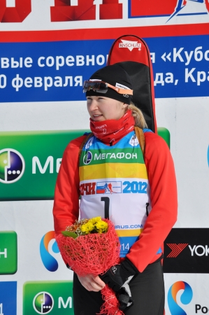 SOCHI, RUSSIA - FEBRUARY 10: Cup of Russia on biathlon in Sochi on February 10, 2012. The combined ski-biathlon complex Laura for the Games 2014. Winner Darya Novikova during flower ceremony