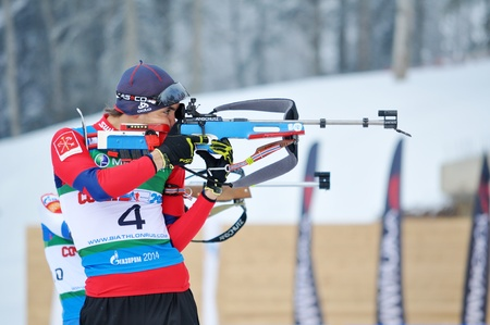 purposefulness: SOCHI, RUSSIA - FEBRUARY 10: Cup of Russia on biathlon in Sochi on February 10, 2012. The combined ski-biathlon complex Laura for the Olympic Games 2014. Alexander Kuzmin on a firing line Editorial