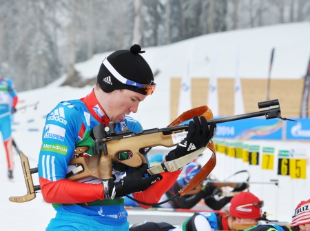 prosecution: SOCHI, RUSSIA - FEBRUARY 10: Cup of Russia on biathlon in Sochi on February 10, 2012. The combined ski-biathlon complex Laura for the Games 2014. Dmitry Elhin on a firing line. Mans  prosecution race Editorial