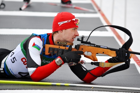 purposefulness: SOCHI, FEBRUARY 10  Cup of Russia on biathlon in Sochi on February 10, 2012  The combined ski-biathlon complex Laura for the Games 2014  Nikita Merzljakov on a firing line