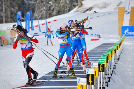 prosecution: SOCHI, RUSSIA - FEBRUARY 10  Cup of Russia on biathlon in Sochi on February 10, 2012  The combined ski-biathlon complex Laura for the Games 2014  On a firing line  Female prosecution race