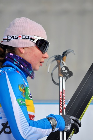 purposefulness: SOCHI, RUSSIA - FEBRUARY 10  Cup of Russia on biathlon in Sochi on February 10, 2012  The combined ski-biathlon complex  Laura  for the Games 2014  Galina Nechkasova finishing