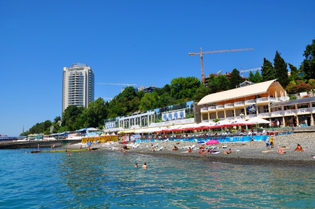 SOCHI, RUSSIA - JULY 20  People swim and sunbathe at the beach resort of Sochi, Russia on JULY 20, 2012  In 2012, in Sochi SPA resort rested more than 3 8 million people