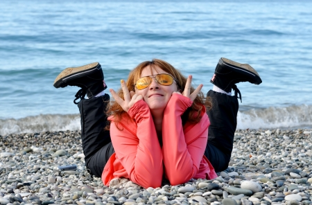 Happy tourist woman at the seaside photo