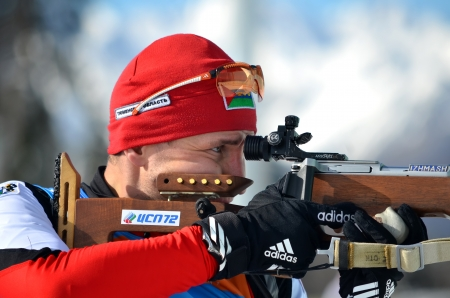 attentiveness: SOCHI, RUSSIA - FEBRUARY 9  Sergey Balandin competes in IBU Regional Cup in Sochi on February 9, 2013  The combined ski-biathlon complex  Laura   Men