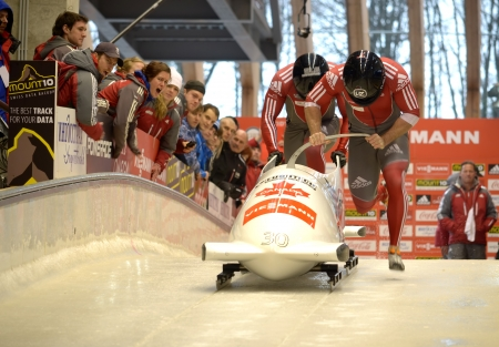 SOCHI, RUSSIA - FEBRUARY 16: FIBT Viessmann Bobsleigh @ Skeleton World Cup on February 16, 2013 in Sochi, Russia. Center Luge Sanki. Team Russia on track