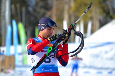 attentiveness: SOCHI, RUSSIA - FEBRUARY 9  Anatoly Oskin competes in IBU Regional Cup in Sochi on February 9, 2013  The combined ski-biathlon complex  Laura   Men