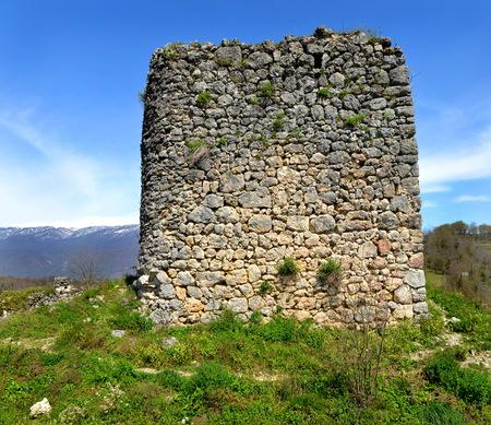 abkhazia: Abkhazia, the ruins of the Genoese fortress tower in Gudauta region  Stock Photo