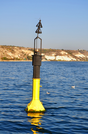 black moor: Black and yellow channel marker on the Black Sea, South Bay of Sevastopol, Crimea, Ukraine