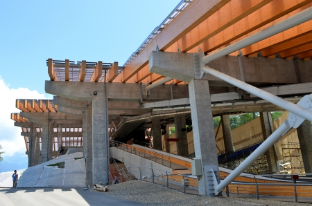 luge: SOCHI, RUSSIA - JULY 10: Construction of Sanki Luge Center for Winter Olympics 2014 on July 10, 2013 in Sochi, Russia. Center Luge Sanki. Capacity development: 5000 spectators. After the Olympics to be used as the National Training Center.   Editorial