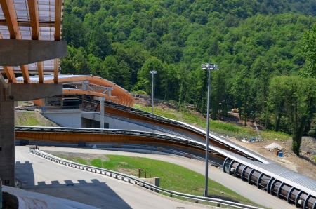 luge: SOCHI, RUSSIA - JULY 10: Construction of Sanki Luge Center for Winter Olympics 2014 on July 10, 2013 in Sochi, Russia. Center Luge Sanki. Capacity development: 5000 spectators. After the Olympics to be used as the National Training Center Editorial