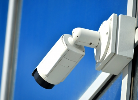 Surveillance camera outdoors on a modern glass facade photo