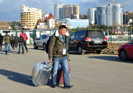 arrived: SOCHI, RUSSIA - FEBRUARY 6, 2014: Unknown journalist from Kazakhstan arrived in Sochi for the Olympics 2014 Editorial