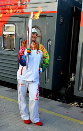 SOCHI, RUSSIA - FEBRUARY 7, 2014: Olypmic champion Tatiana Navka with the Olympic torch at the Olympic torch relay in Sochi Editorial