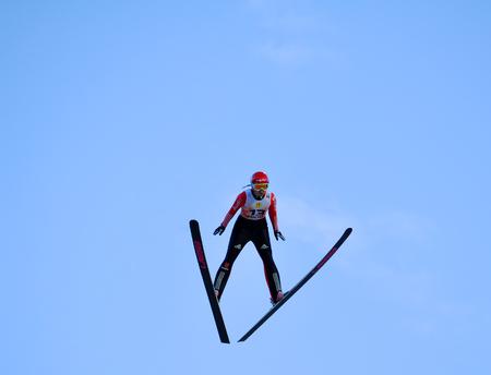 composure: SOCHI, RUSSIA - DECEMBER 9, 2012  FIS Ski Jumping World Cup in Sochi on tramplin complex  RusSki Gorki   Unidentified athlete in flight