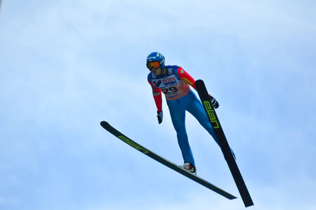 gorki: SOCHI, RUSSIA - DECEMBER 9, 2012  FIS Ski Jumping World Cup in Sochi on tramplin complex  RusSki Gorki   Unidentified athlete in flight