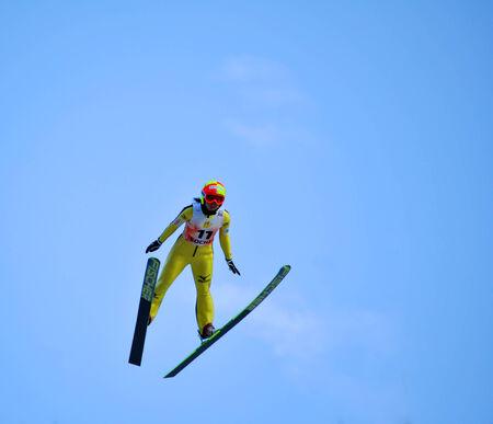 gorki: SOCHI, RUSSIA - DECEMBER 9, 2012  FIS Ski Jumping World Cup in Sochi on tramplin complex  RusSki Gorki   Unidentified Japanise female athlete in flight