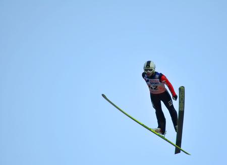 attentiveness: SOCHI, RUSSIA - DECEMBER 9, 2012  FIS Ski Jumping World Cup in Sochi on tramplin complex  RusSki Gorki   Unidentified athlete from Italy in flight