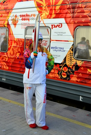 SOCHI, RUSSIA - FEBRUARY 7, 2014  Olypmic champion Tatiana Navka with the Olympic torch at the Olympic torch relay in Sochi