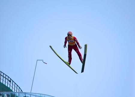 gorki: SOCHI, RUSSIA - DECEMBER 9, 2012: FIS Ski Jumping World Cup in Sochi on tramplin complex RusSki Gorki. Unidentified athlete in flight.