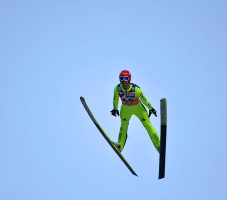 attentiveness: SOCHI, RUSSIA - DECEMBER 9, 2012: FIS Ski Jumping World Cup in Sochi on tramplin complex RusSki Gorki. Unidentified athlete in flight.