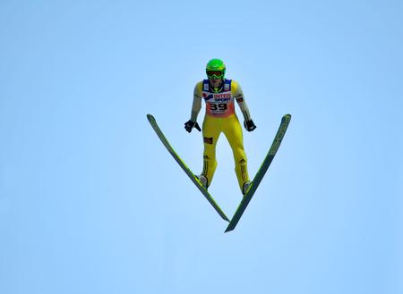 SOCHI, RUSSIA - DECEMBER 9, 2012: FIS Ski Jumping World Cup in Sochi on tramplin complex RusSki Gorki. Unidentified athlete in flight.