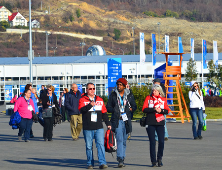 SOCHI, RUSSIA - FEBRUARY 7, 2014: Fans and volunteers at the entrance to the Olympic Park a few hours before the opening ceremony of the Olympic Games 2014