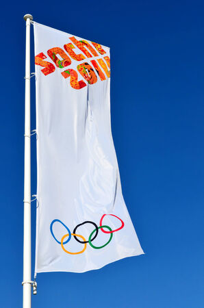 SOCHI, RUSSIA - FEBRUARY 7, 2014: Olympic flag with the symbol of the Sochi 2014 in Olympic park Editorial