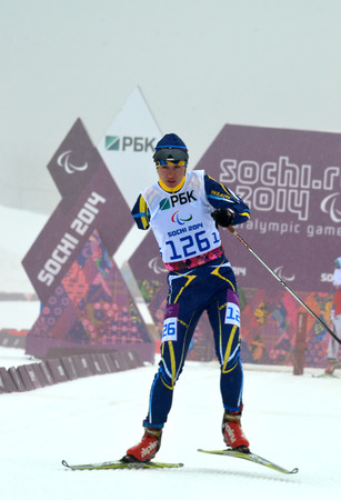SOCHI, RUSSIA - March 11, 2014: Iuliia Batenkova (Ukraine) competes on Winter Paralympic Games  in Sochi. Biathlon, Women's 10 km, standing 版權商用圖片 - 26759304