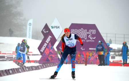 paralympic: SOCHI, RUSSIA - March 11, 2014: Alena Kaufman (Russia) competes on Winter Paralympic Games  in Sochi. Biathlon, Women's 10 km, standing