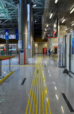 SOCHI, RUSSIA - March 5, 2014: Floorstanding tactile markings for the blind and a pointer for people with disabilities at the railway station in Krasnaya Polyana, Sochi