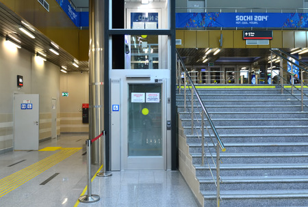SOCHI, RUSSIA - MARCH 5, 2014: Elevator for people with disabilities at the railway station in Krasnaya Polyana - equipment for successful XI Winter Paralympic Games