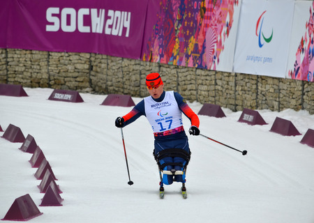 paralympic: SOCHI, RUSSIA - March 9, 2014: Alexander Davidovich (Russia) competes on Winter Paralympic Games  in Sochi. Biathlon, Men�s 15 km, sitting