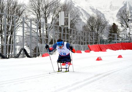 SOCHI, RUSSIA - March 9, 2014: Irek Zaripov (Russia) competes on Winter Paralympic Games  in Sochi. Biathlon, Men�s 15 km, sitting