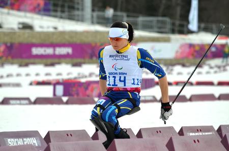 SOCHI, RUSSIA - March 9, 2014: Lyudmila Pavlenko (Ukraine) competes on Winter Paralympic Games  in Sochi. Biathlon, Women�s 12,5 km, sitting