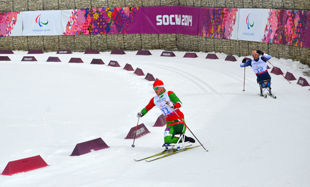 SOCHI, RUSSIA - March 9, 2014: Yevgeniy Lukyanenko (Belarus) and Andrew Soule (USA) competes on Winter Paralympic Games  in Sochi. Biathlon, Men�s 15 km, sitting