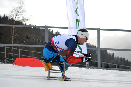 SOCHI, RUSSIA - March 9, 2014: Roman Petushkov (Russia) competes on Winter Paralympic Games  in Sochi. Biathlon, Men�s 15 km, sitting