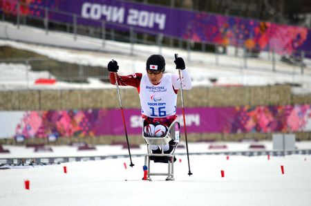 paralympic: SOCHI, RUSSIA - March 9, 2014: kozo Kubo (Japan) competes on Winter Paralympic Games  in Sochi. Biathlon, Men's 15 km, sitting Editorial