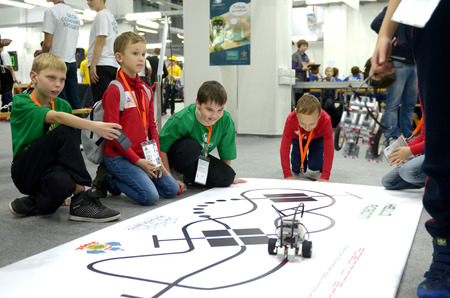 SOCHI, RUSSIA – November 21, 2014: Childrens of Team Russia at the robot Olympiad in Sochi. Here there was the World Robotic Olympiad 2014