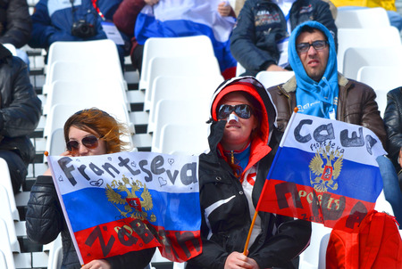 SOCHI, RUSSIA - March 16, 2014: Sport funs with national flags in support of Alexandra Frantseva on Winter Paralympic Games  in Sochi.